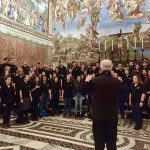 The Concert Choir, led by Jamie Spillane, sings at the Sistine Chapel under Michelangelo's most famous painting.