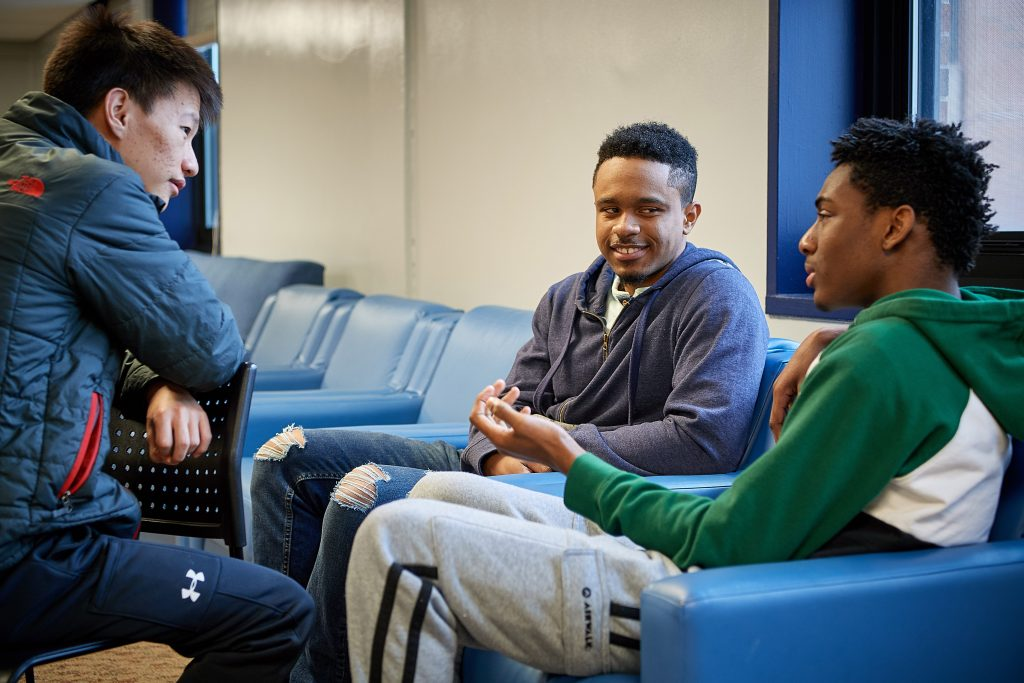 Norwyn Campbell '20 (ENG), center, with Rabjam Rabjam '21 (ENG), left, and Renaldo Lawson '21 (CLAS) in a lounge at Eddy Residence Hall. (Peter Morenus/UConn Photo)