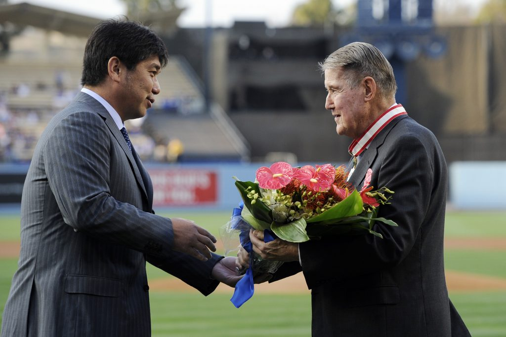Former Los Angeles Dodgers pitcher Hideo Nomo, presents flowers to former Dodgers President Peter O'Malley (R) after he received The Order of the Rising Sun, Gold Rays with Neck Ribbon from Harry H. Horinouchi, consul general of Japan in Los Angeles, as part of Japan Night celebration at Dodger Stadium prior to the start of a baseball game between the Dodgers and the Philadelphia Phillies July 8, 2015 at Dodger Stadium in Los Angeles, California. (Photo by Kevork Djansezian/Getty Images)