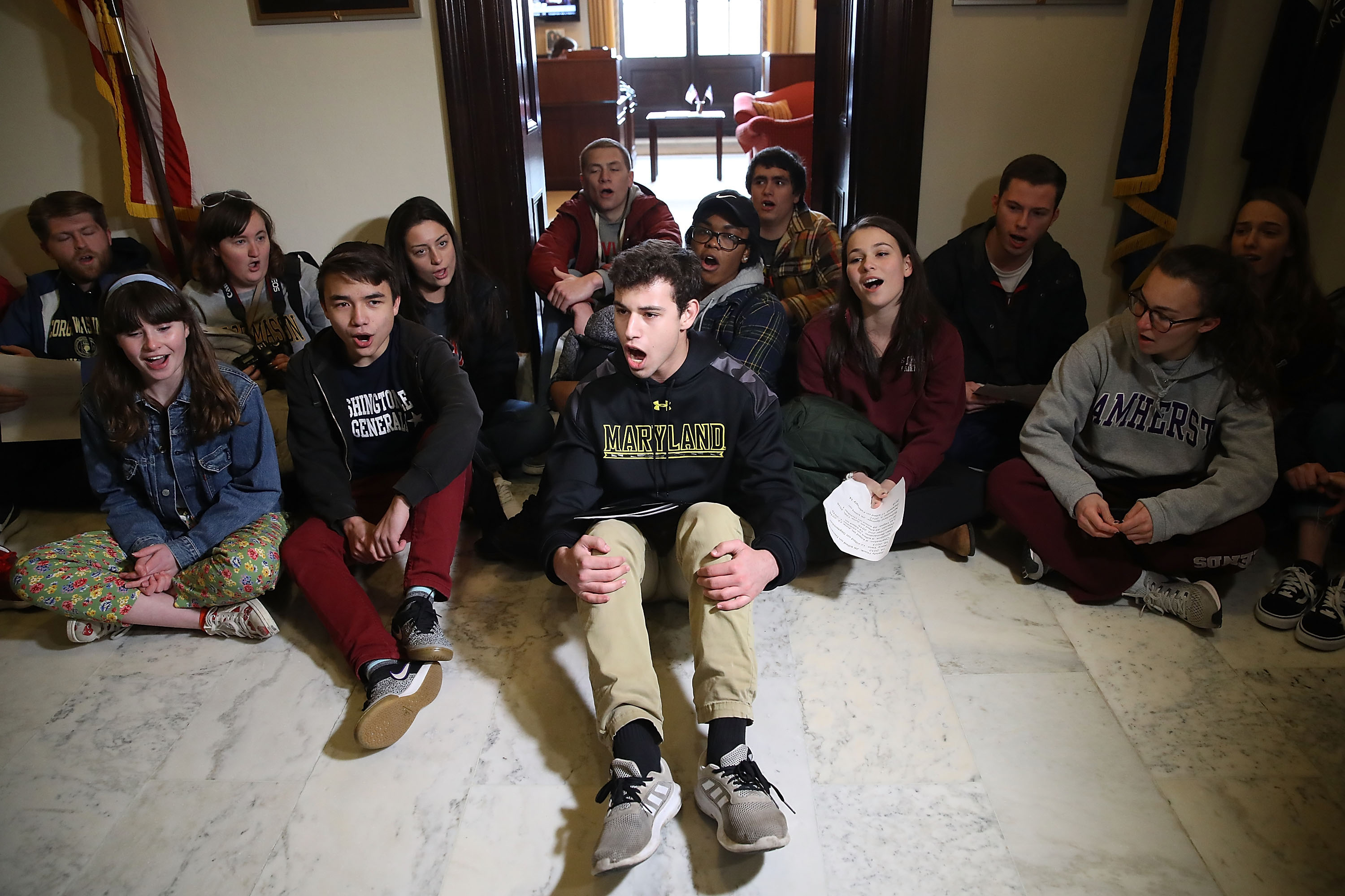 Today, students all over the country took part in 17-minute protests, one minute for each person who died in the high school massacre in Parkland, Florida. In this photo, students protest in front of Senate Majority Leader Mitch McConnell's (R-KY) office to urge Congress into changing gun laws on March 7 in Washington, D.C. (Mark Wilson/Getty Images)