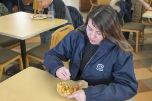 A student tucks into a bowl of chickpea rotini at Northwest Dining Hall. (Jeff Gonci/UConn Photo)
