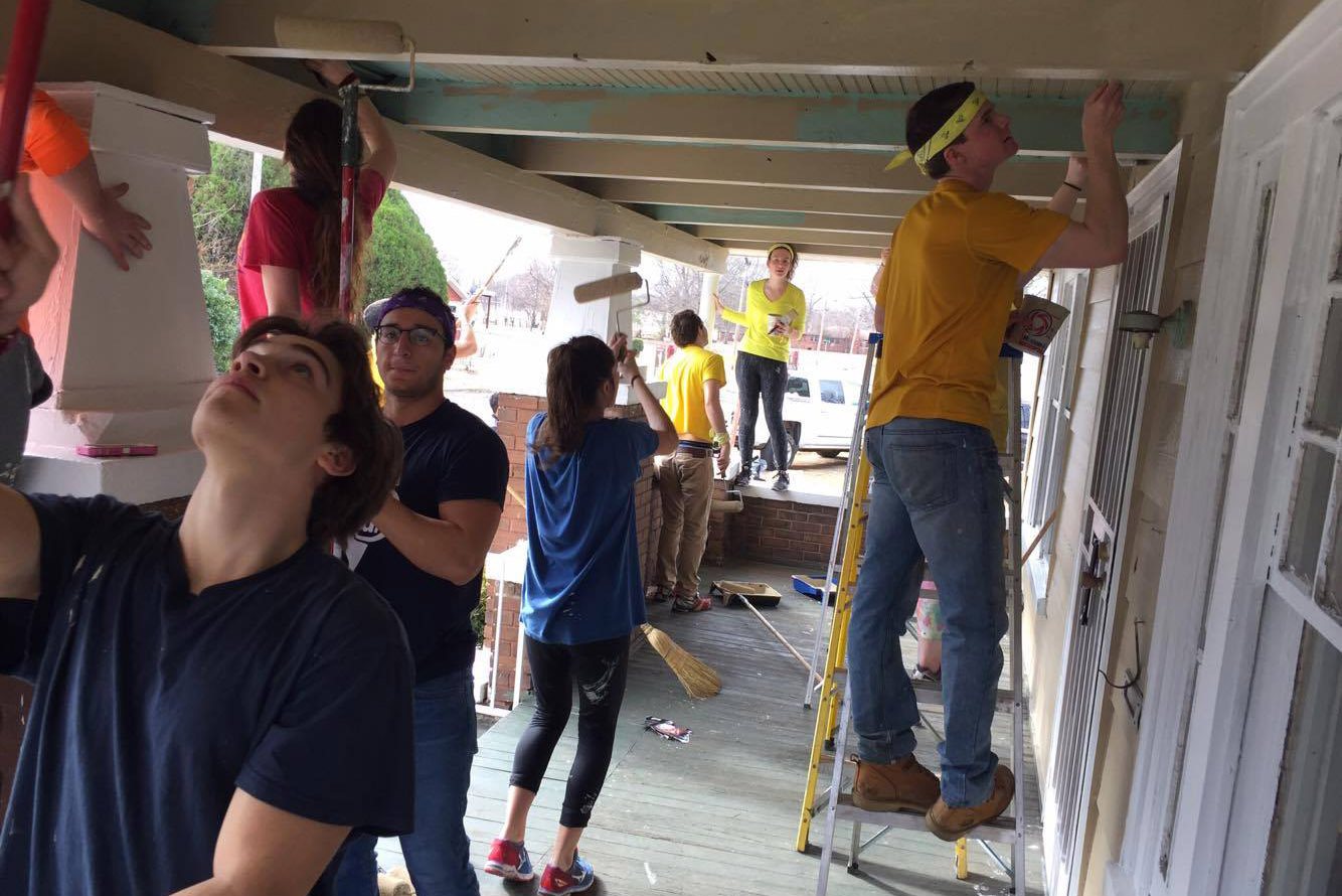 UConn students on an Alternative Break trip to Birmingham, Alabama, help fix up a house in a low-income neighborhood. (Community Outreach/UConn Photo)