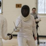 A bout starts with the fencers in the en-garde position, 4 metres (or 13.1 feet) apart. During a bout, the fencers move up and down a piste, or fencing strip. (Garrett Spahn '18 (CLAS)/UConn Photo)