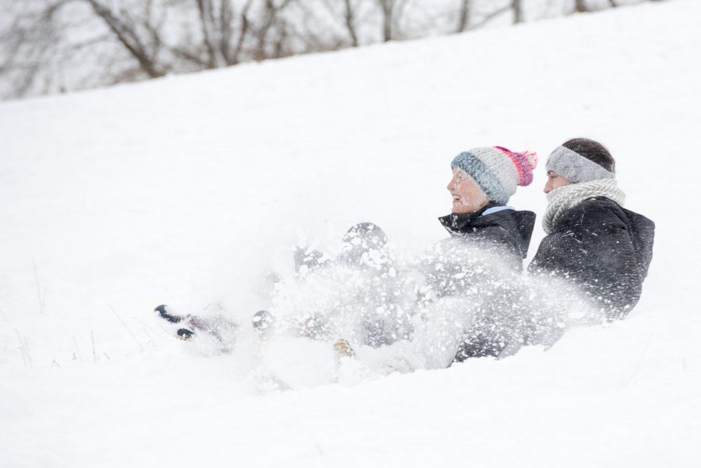 Students sledding down Horsebarn Hill. (Sean Flynn/UConn File Photo)