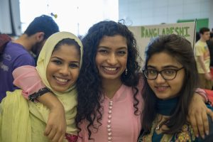 From left, Roushan Ahmed, a senior history major, Armana Islam, a freshman biology and women's, gender, and sexuality studies major, and Amrin Choudhury, a freshman accounting major, all members of the Bangladesh Students Association, at Worldfest. (Garrett Spahn '18 (CLAS)/UConn Photo)