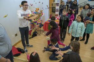Brandon Lira, a sophomore political science major, demonstrates a piñata provided by the Mexican Student Association at Worldfest. (Garrett Spahn '18 (CLAS)/UConn Photo)