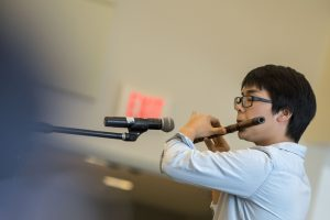 Qian Xu of the Chinese Student and Scholar Association plays a wind instrument at Worldfest. (Garrett Spahn '18 (CLAS)/UConn Photo)