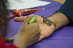 UConn Tarang, a group representing the South Asian graduate student community at UConn, gives henna tattoos at Worldfest. Tarang helps international students from India, Pakistan, Sri Lanka, Bangladesh, Nepal, Bhutan, and the Maldives to acclimate to UConn. (Garrett Spahn '18 (CLAS)/UConn Photo)