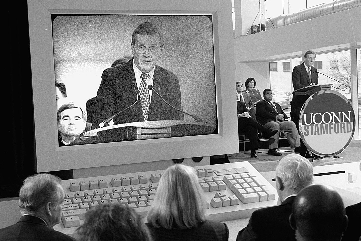 His image projected on a giant mockup computer, then-President Austin speaks at the Stamford campus dedication on April 17, 1998. (Peter Morenus/UConn File Photo).