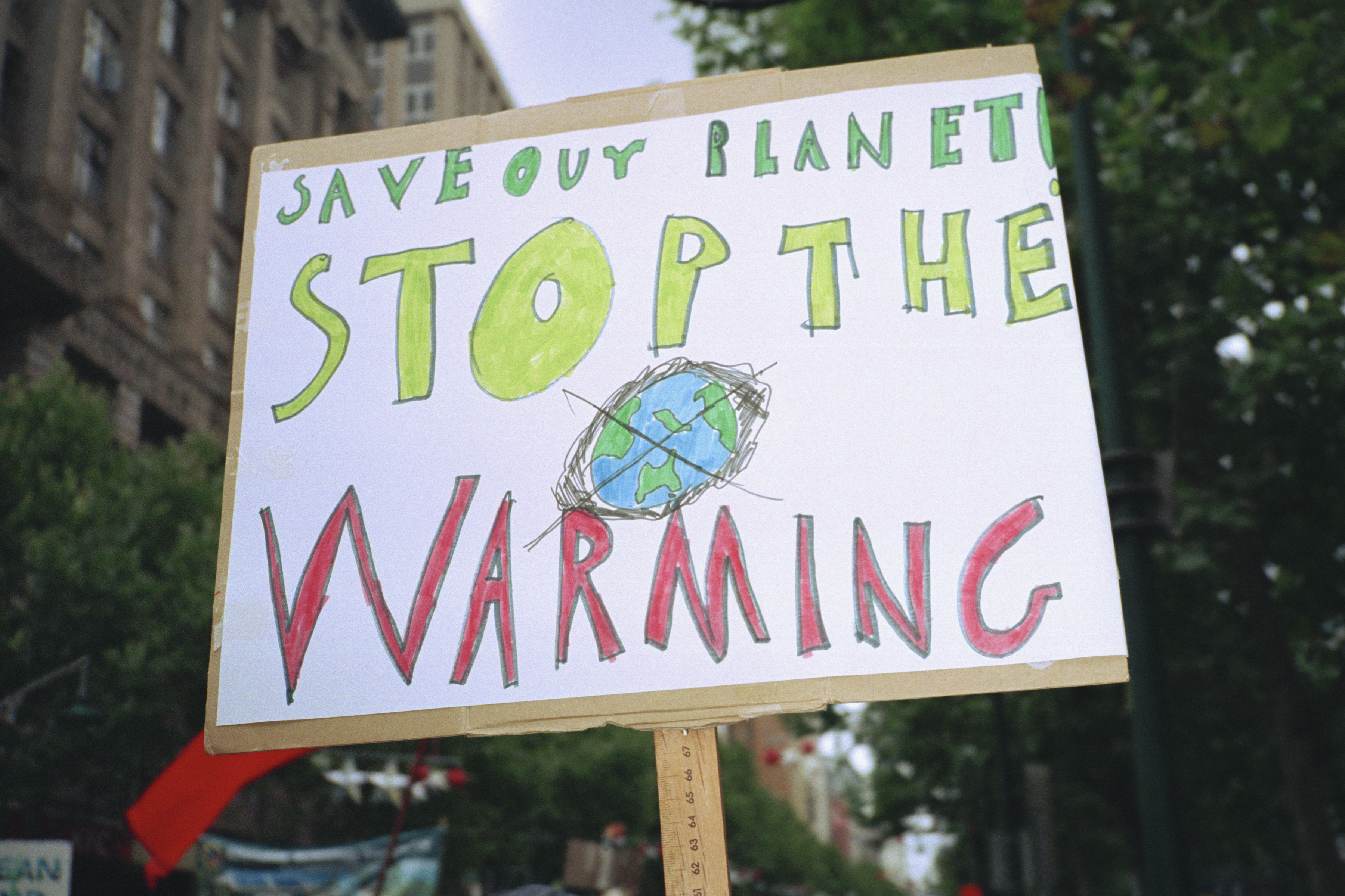 A global warming placard on display in a city. (Getty Images)