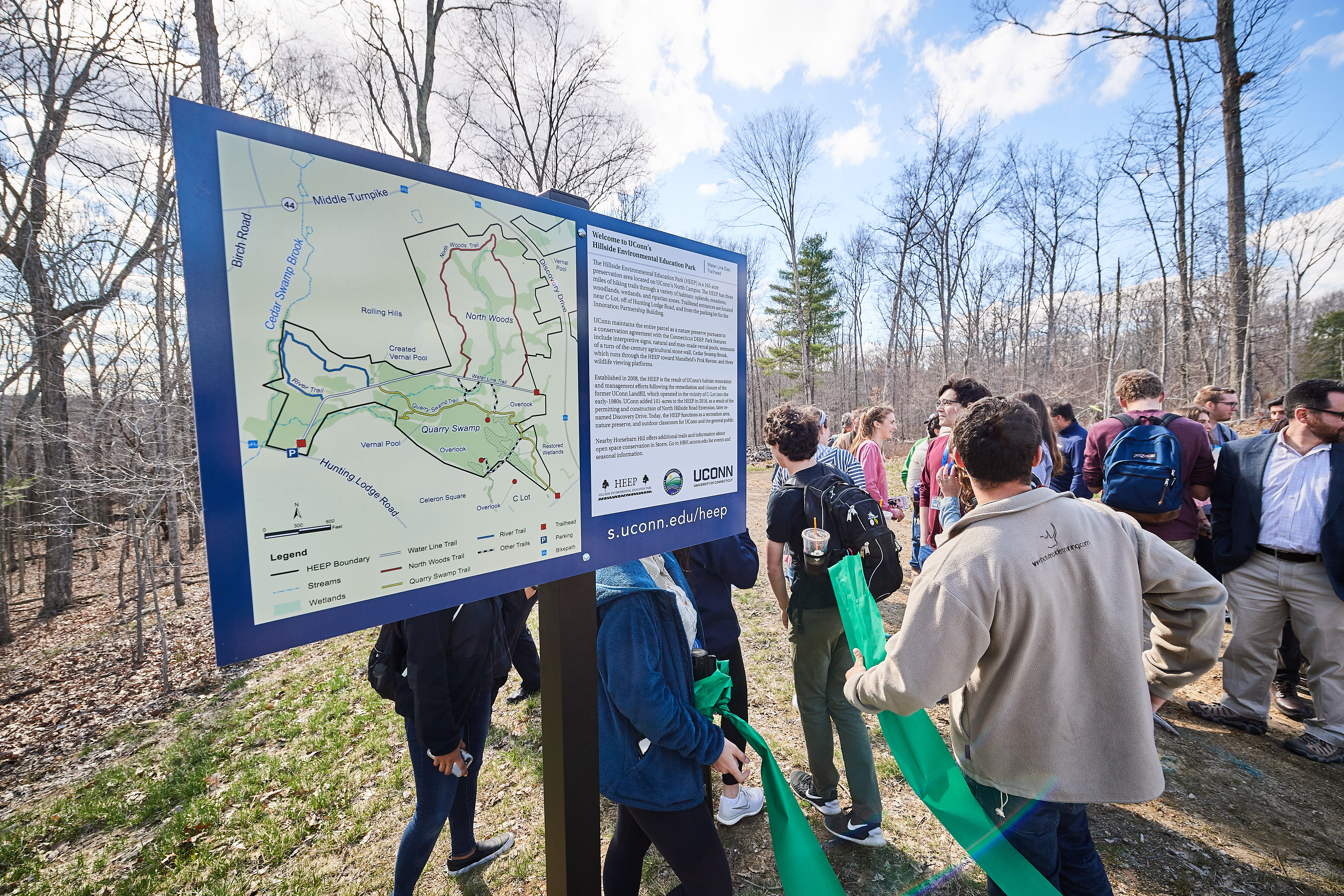 A group hike following the reopening of the Hillside Environmental Education Park trail near the Innovation Partnership Building on April 26, 2018. (Peter Morenus/UConn Photo)