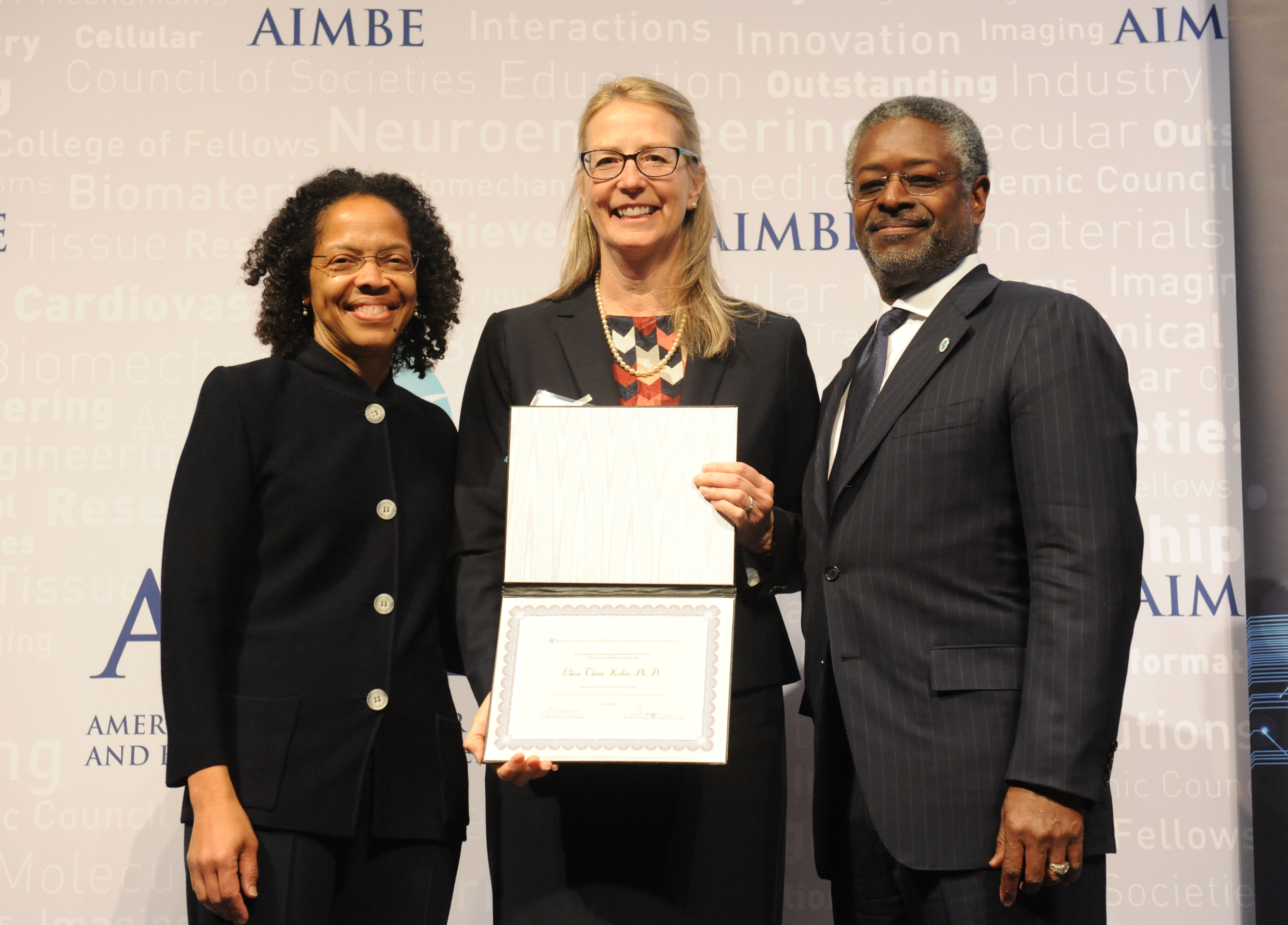 Liisa Kuhn, center, is inducted into the AIMBE Fellows National Academy of Sciences. She is joined by AIMBE President Gilda Barabino (left) and AIMBE Chair Anthony Guiseppi-Elie (right). (AIMBE Fellows Photo)