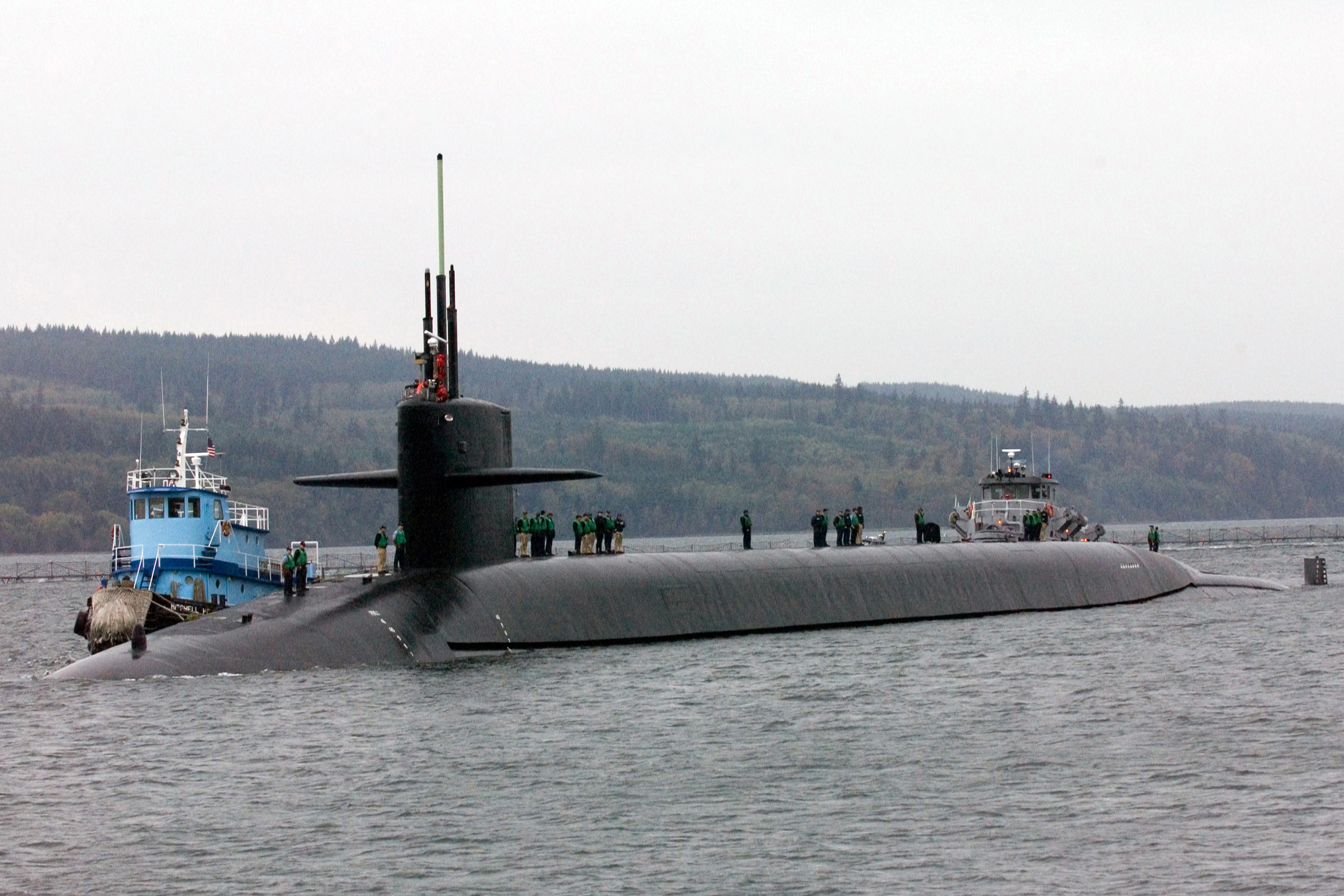 The USS Louisiana (SSBN743) is arriving for the first time at their new homeport at Naval Base Kitsap, Silverdale, Washington,on October 12, 2005. The USS Louisiana was formerly homeported at Kings Bay, Georgia. US Navy (Photo of the USS Louisiana by Brian Nokell, NBK Visual Information, via Wikimedia Commons)