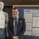 Ryan Gadea, a senior biomedical engineer, displays the low-profile sensor he created to help people with multiple sclerosis move more quickly and easily. (Garrett Spahn '18 (CLAS)/UConn Photo)