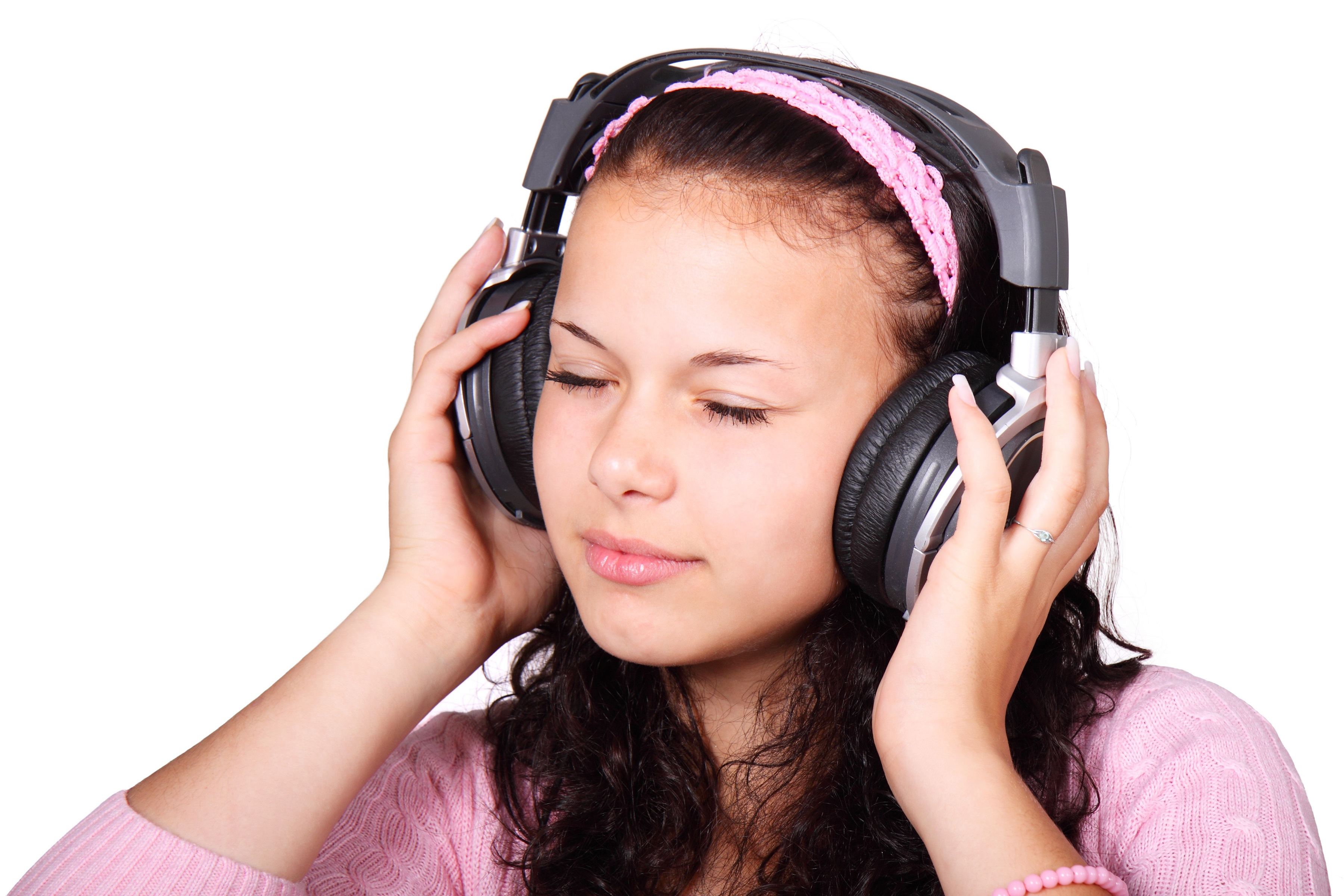 A girl listens to music via headphones. (Pixabay Photo)