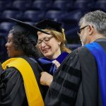 Kimberly Bryant, founder and executive director of Black Girls Code, left, who received an honorary Doctor of Science degree, is hooded by President Susan Herbst and Dean Kazem Kazerounian during the School of Engineering Commencement ceremony at Gampel Pavilion on May 5, 2018. (Peter Morenus/UConn Photo)