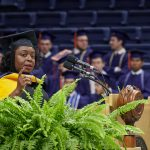 Kimberly Bryant, founder and executive director of Black Girls Code, gives the address at the School of Engineering Commencement ceremony. (Peter Morenus/UConn Photo)