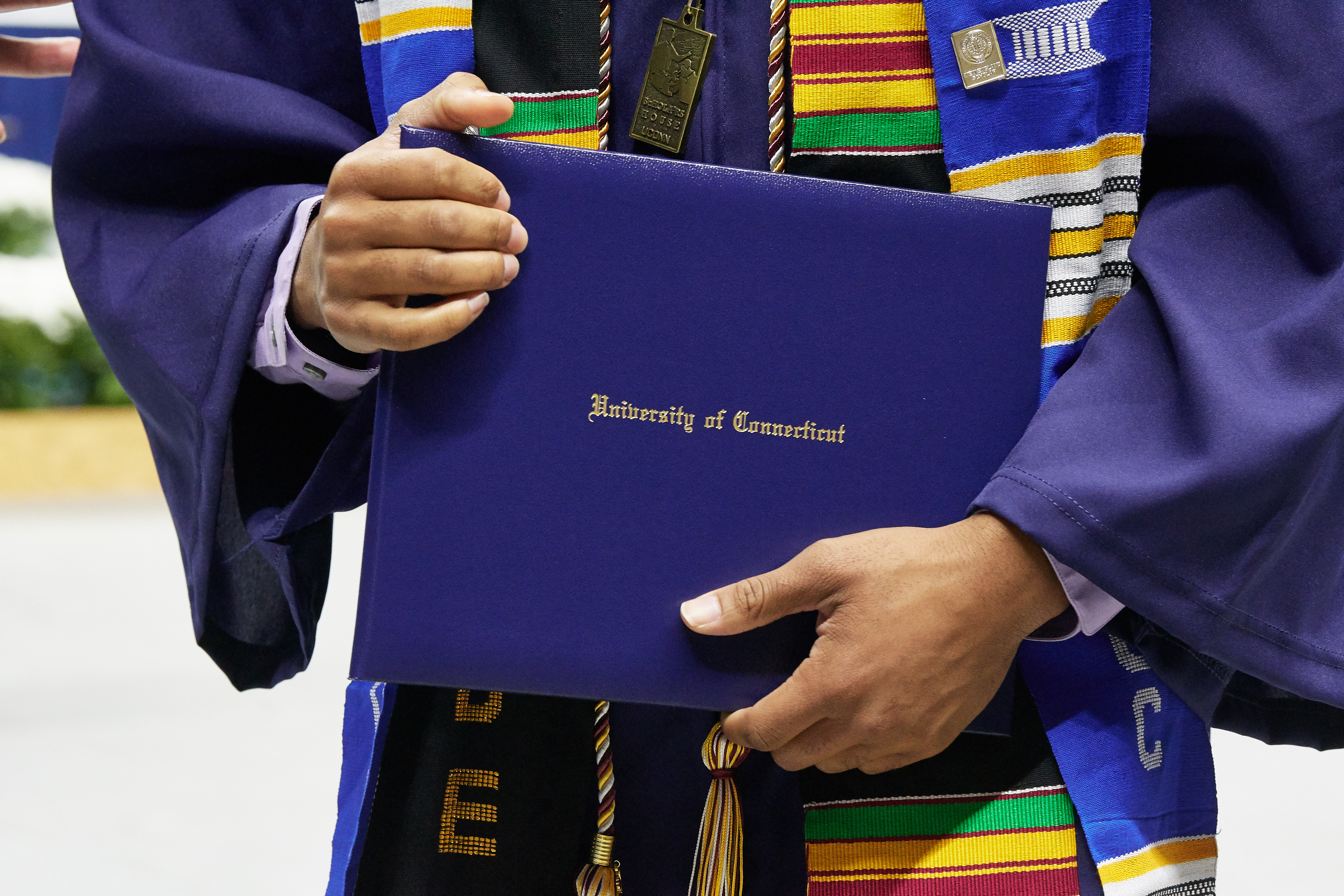 A degree candidate holds a diploma case during the School of Engineering Commencement ceremony at Gampel Pavilion on May 5, 2018. (Peter Morenus/UConn Photo)
