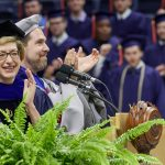 President Susan Herbst, left, and Daniel Burkey, associate dean of engineering, clap following the conferral of degrees at the School of Engineering Commencement ceremony. (Peter Morenus/UConn Photo)