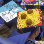 David Mill '18 (CLAS) shows off his spaghetti cap during the College of Liberal Arts and Sciences Commencement ceremony at Gampel Pavilion on May 6. (Sean Flynn/UConn Photo)