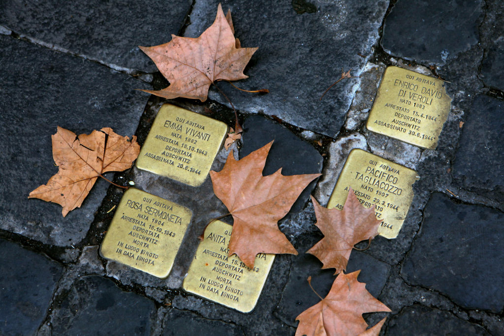 Small bronze plaques in memory of victims of the Holocaust are seen between the paving stones of the Jewish Ghetto in Rome, Italy. The Roman Jewish Ghetto was originally established by Pope Paul IV in July 1555 as a walled quarter with its gates locked at night and survived until the walls were torn down in September 1870 when it the neighborhood remained the heart of the city's Jewish community. In October 1943 the Holocaust reached Rome when German Nazi troops entered the area and deported over 2,000 Jews, of which only about 100 survived the war. The quarter today is a bustling neighborhood famous for its ethnic Jewish food and restaurants. (Photo by David Silverman/Getty Images)