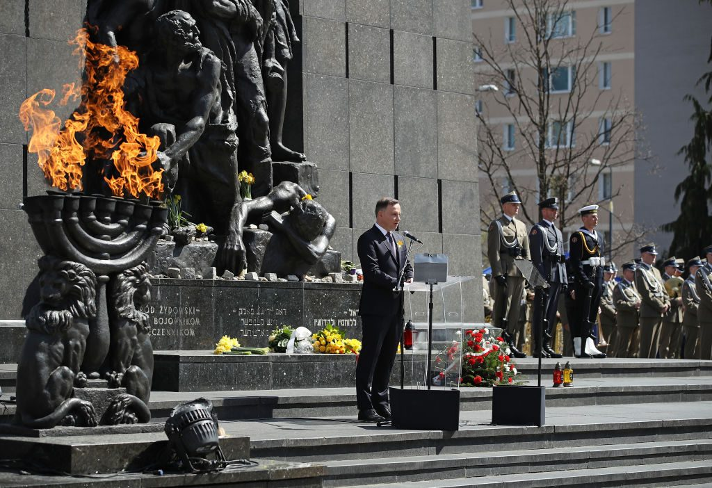 Polish President Andrzej Duda speaks at a memorial to the Warsaw Ghetto Uprising during the main commemoration ceremony of the 75th anniversary of the uprising on April 19, 2018 in Warsaw, Poland. The Warsaw Ghetto was a prison created by the German military during its occupation of Warsaw during World War II. Starting in 1940, 400,000 Jews were confined to a walled-in neighborhood of 3.4 square kilometers under horrific conditions. With assistance from Polish partisans the Jews rose up in armed resistance in 1943 and held off the Germans for several weeks until the Germans annihilated the ghetto, killing 13,000 people. In all 392,000 Jews from the Warsaw ghetto were killed, most of them after deportation to the Treblinka death camp. (Photo by Sean Gallup/Getty Images)