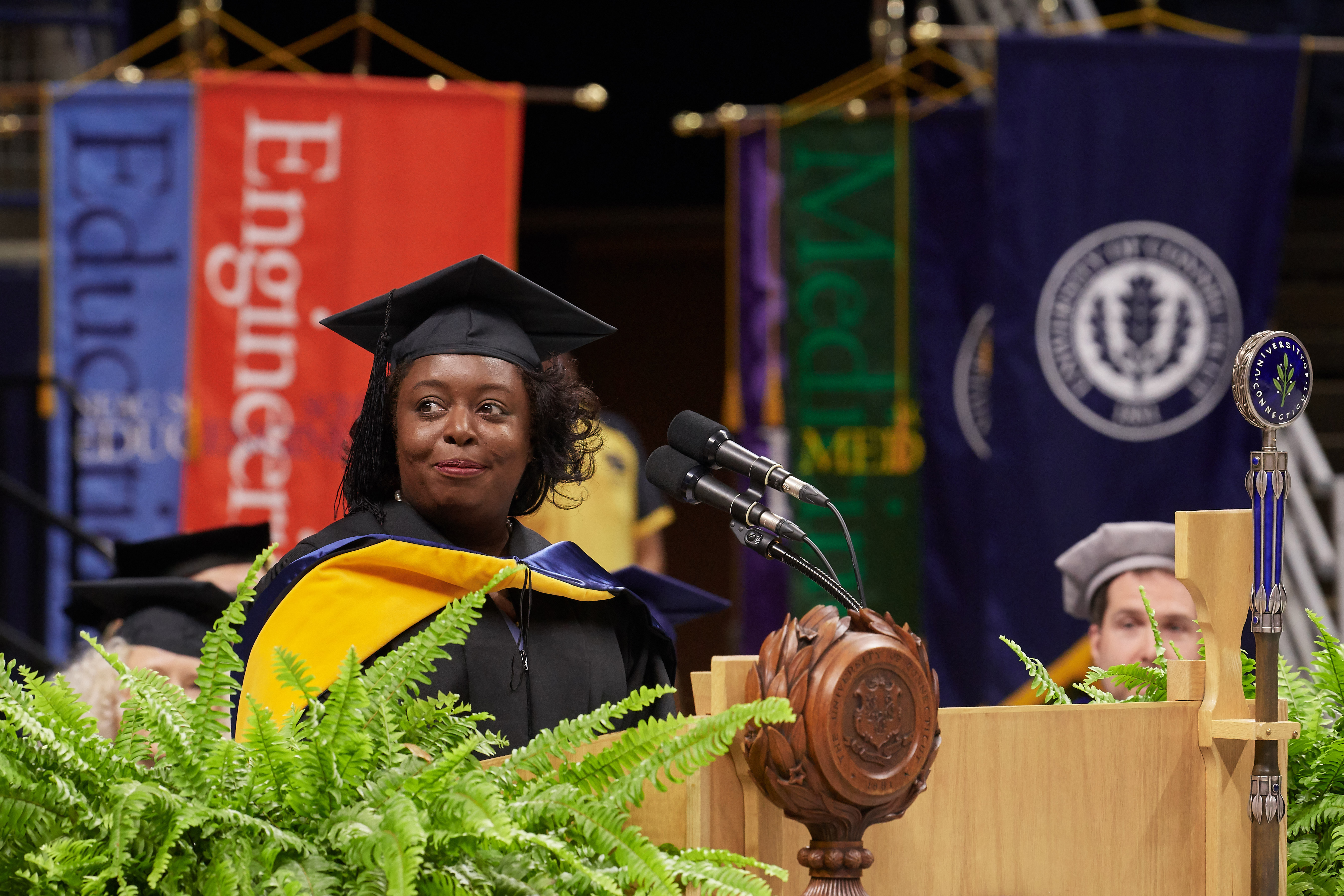 Kimberly Bryant, founder and executive director of Black Girls Code, gives the address at the School of Engineering Commencement ceremony at Gampel Pavilion on May 5, 2018. (Peter Morenus/UConn Photo)