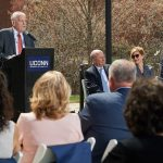 Larry McHugh, chairman emeritus of the Board of Trustees, speaks at the ceremony held on the Student Union Mall to name the former Laurel Hall in his honor. (Peter Morenus/UConn Photo)