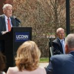 Larry McHugh, chairman emeritus of the Board of Trustees, speaks at the event held on the Student Union Mall to celebrate the naming of the former Laurel Hall in his honor on May 2. (Peter Morenus/UConn Photo)
