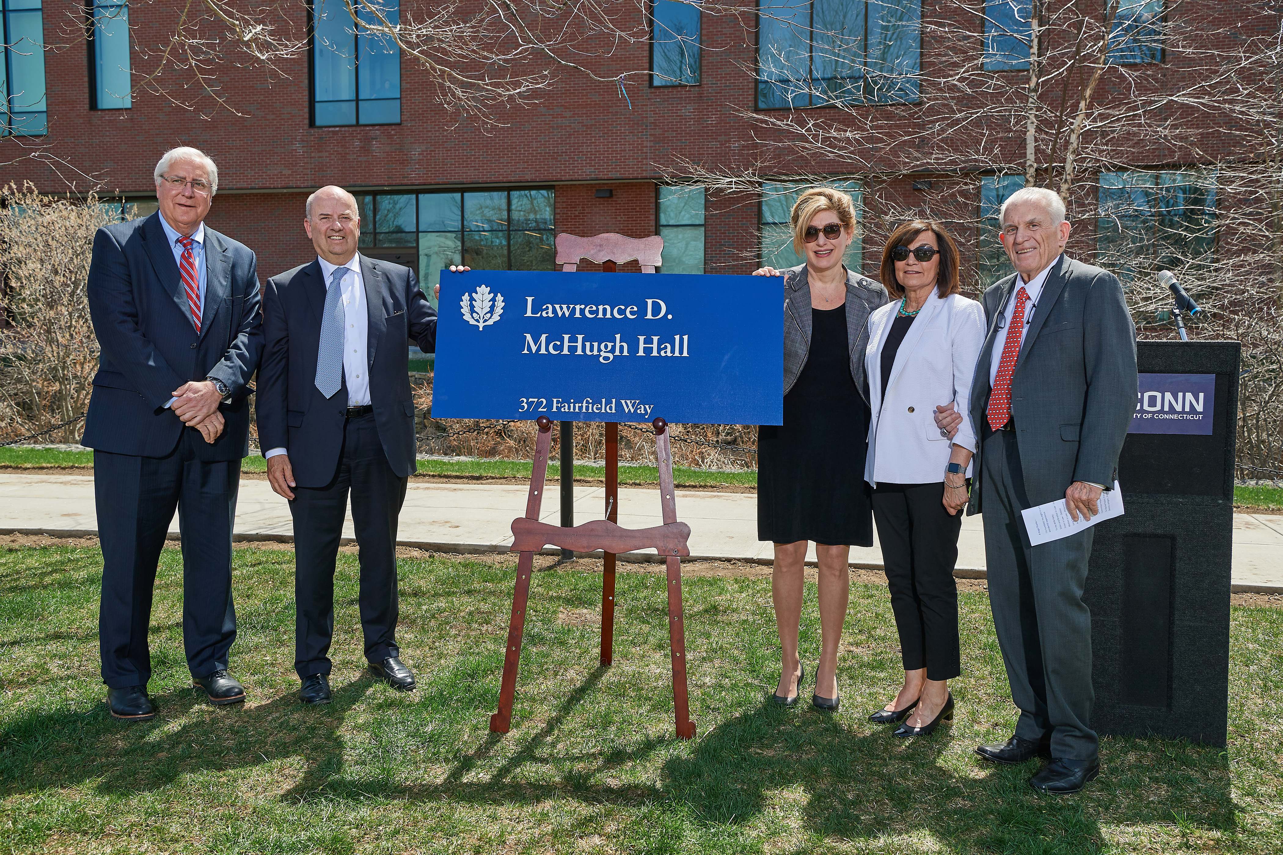 From left, Thomas Ritter '77 JD, Thomas Kruger, President Susan Herbst, Patricia McHugh, and Larry McHugh at the ceremony held to celebrate the naming of Lawrence D. McHugh Hall on May 2, 2018. (Peter Morenus/UConn Photo)