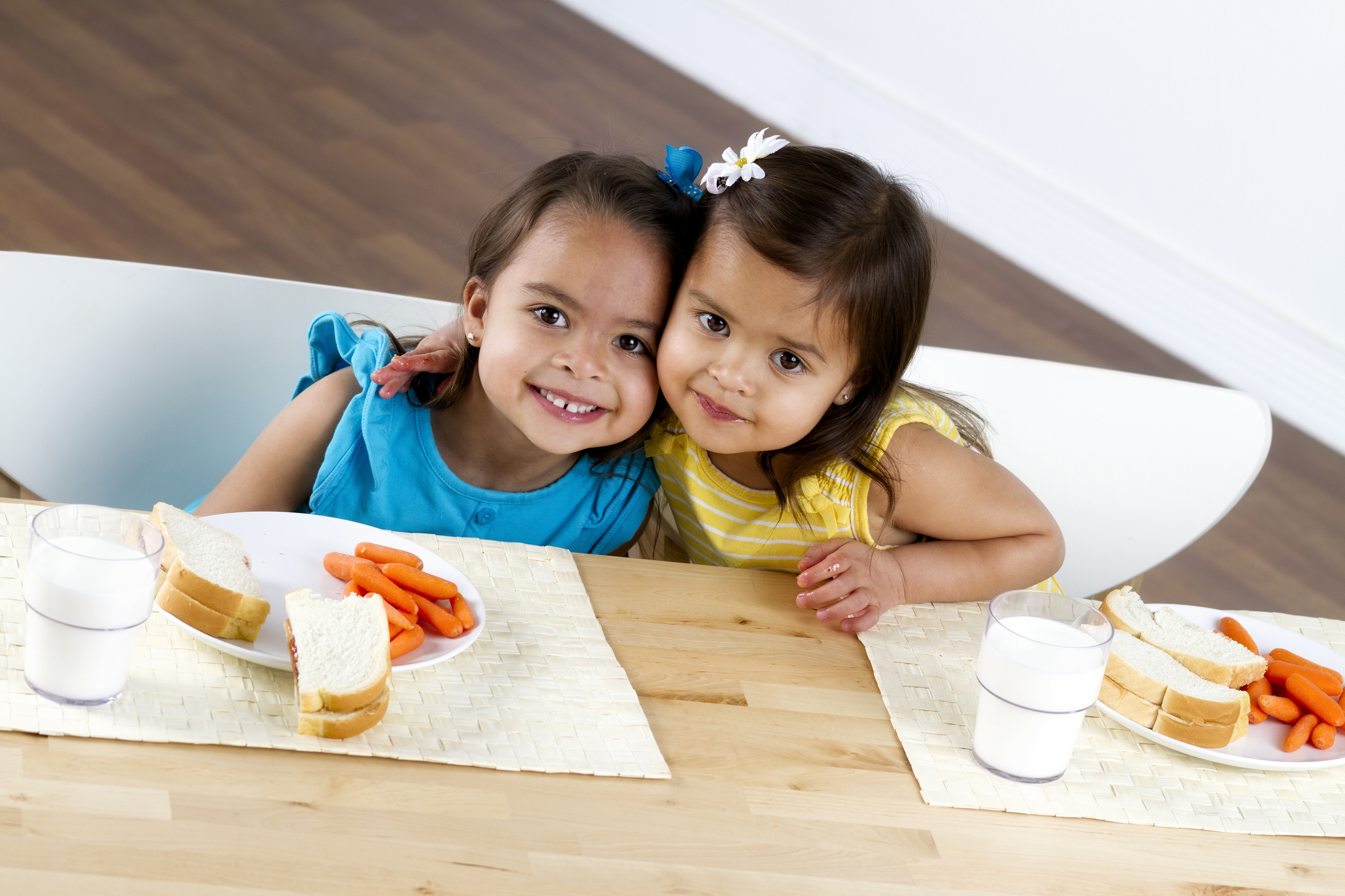 Two little girls eating lunch. (iStock Photo)