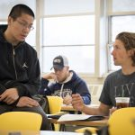 Baseball player Chris Winkel '20 (BUS), right, talks with teaching assistant Jungang Li during a Calculus for Business and Economics class in Monteith. To Winkel, being a Husky is having 'a mindset to embrace every obstacle ahead ... and overcome it.' (Sean Flynn/UConn Photo)