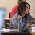 Student-athlete, Zaina Zaki '18 (BUS) listens to a lecture on financial risk management by finance professor Shantaram Hegde in the School of Business. Zaki tried two different majors before settling on finance. (Sean Flynn/UConn Photo)