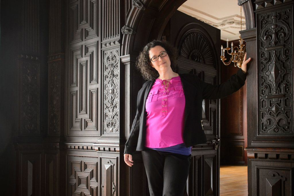 Pamela Bedore, associate professor of English, at the Branford House on Avery Point campus on. (Peter Morenus/UConn Photo)