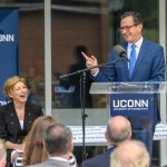 Gov. Dannel Malloy, right, and President Susan Herbst share a laugh at the dedication of the Engineering & Science Building on June 11, 2018. (Peter Morenus/UConn Photo)