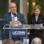 Thomas Kruger, chair of the board of trustees, speaks at the dedication of the Engineering & Science Building on June 11, 2018. At Right is President Susan Herbst. (Peter Morenus/UConn Photo)