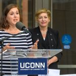 State Senator Mae Flexer '02 (CLAS) speaks at the dedication of the Engineering & Science Building on June 11, 2018. At Right is President Susan Herbst. (Peter Morenus/UConn Photo)