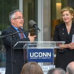 State Rep. Vincent Candelora speaks at the dedication of the Engineering & Science Building on June 11, 2018.  At Right is President Susan Herbst.  (Peter Morenus/UConn Photo)