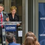 Thomas Prete '85 (ENG), vice president of engineering at Pratt & Whitney, speaks at the dedication of the Engineering & Science Building on June 11, 2018. At Right is President Susan Herbst. (Peter Morenus/UConn Photo)