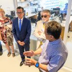 Ki Chon, head of biomedical engineering, shows Gov. Dannel Malloy and others a smart band for measuring heart rate during a tour of the the Engineering & Science Building on June 11, 2018. (Peter Morenus/UConn Photo)