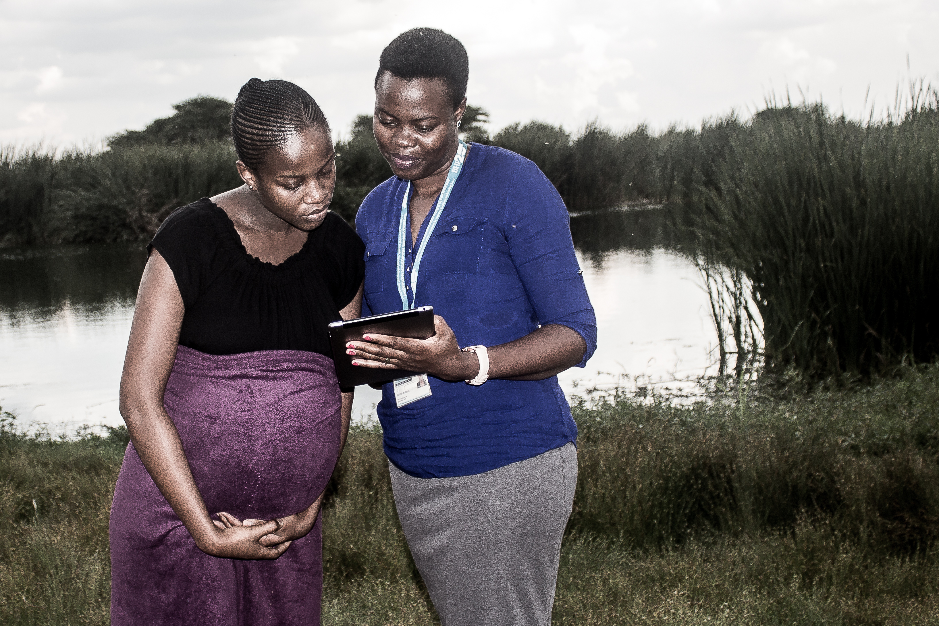 A young mother in Botswana speaks with a health worker. (Moses Mpata/Photo courtesy of the Gates Foundation)