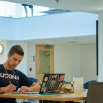 Michael Norell '18 (CLAS) studies at the UConn Hartford Library inside the Hartford Public Library on June 19, 2018. (Peter Morenus/UConn Photo)