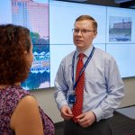 Michael Howser, right, director, speaks with librarian Marisol Ramos in the Digital Scholarship Studio at the UConn Hartford Library inside the Hartford Public Library on June 19, 2018. (Peter Morenus/UConn Photo)