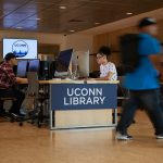 Students use computers at the UConn Hartford Library inside the Hartford Public Library on June 19, 2018. (Peter Morenus/UConn Photo)