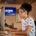 Aubryana Lynch '18 (CLAS), an MSW student, uses a computer at the UConn Hartford Library inside the Hartford Public Library on June 19, 2018. (Peter Morenus/UConn Photo)