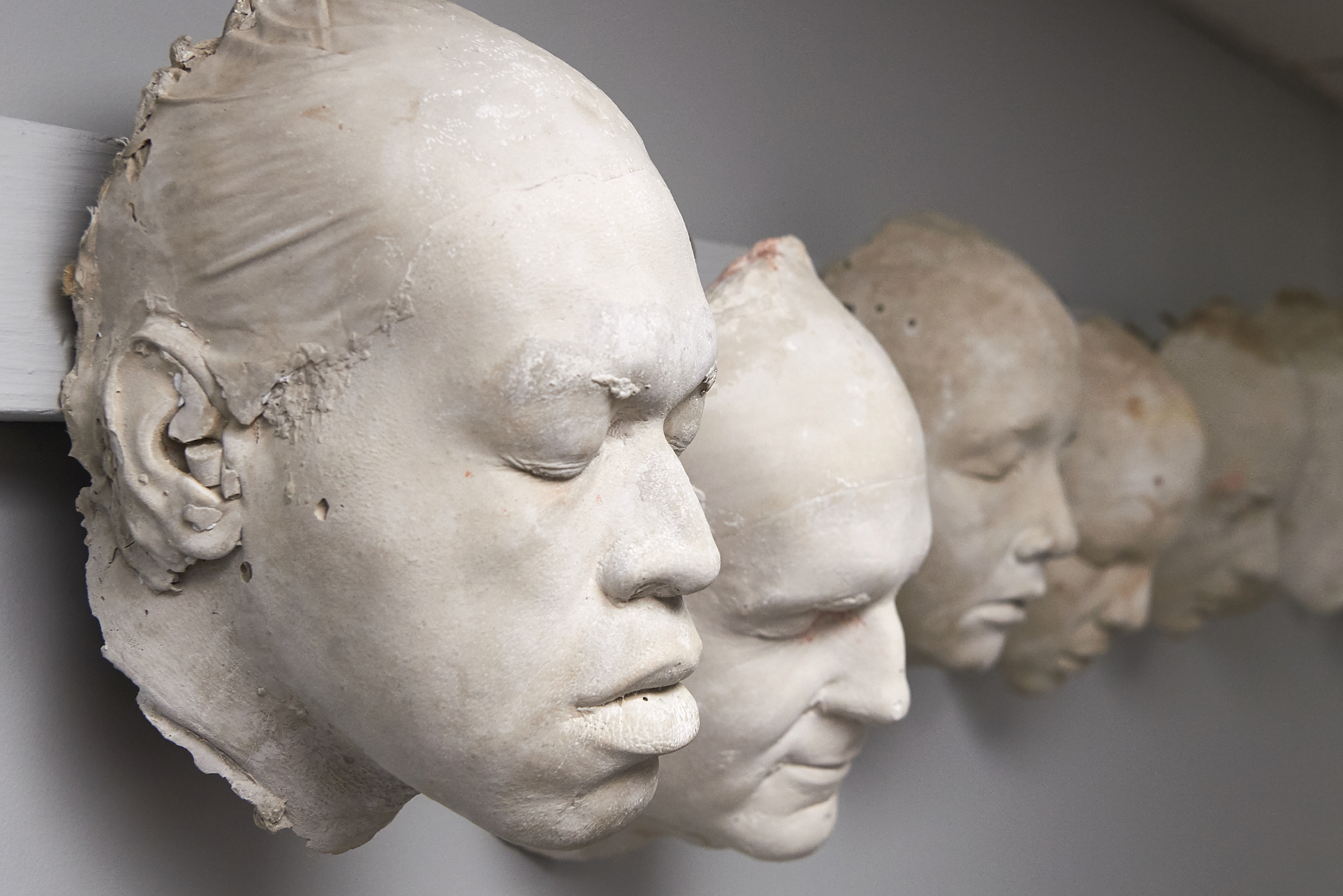 A row of plaster cast heads is among 27 campus treasures and oddities for you to identify. (Peter Morenus/UConn Photo)