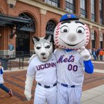 Mascots Jonathan the Husky, left, and Mr. Met outside Citi Field in Queens New York before a New York Mets baseball game on June 3, 2018. (Peter Morenus/UConn Photo)