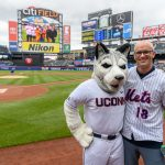 Dan Hurley, right, head coach of UConn Men's Basketball, poses for a photo with Jonathan the Husky before the New York Mets baseball game on June 3, 2018. (Peter Morenus/UConn Photo)