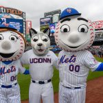 Jonathan the Husky, center, with Mrs. Met, left, and Mr. Met before a New York Mets baseball game at Citi Field in Queens New York on June 3, 2018. (Peter Morenus/UConn Photo)