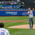 Dan Hurley, right, head coach of UConn Men's Basketball, throws out the ceremonial first pitch to be caught by Rob Stone, '09 (CLAS), left, vice president for business development at SS&C Technologies at a New York Mets baseball game at Citi Field in Queens New York on June 3, 2018. (Peter Morenus/UConn Photo)